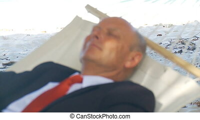 shot transition senior manager in hammock