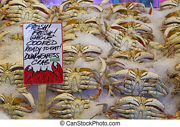Fresh Cooked Dungeness Crabs on Ice at Pike Place Public...