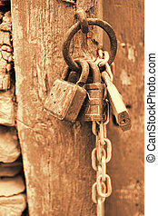 Vintage Corroded Padlocks with Chain on a Ancient Gate...