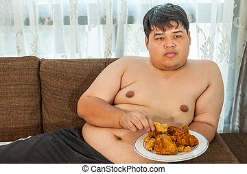 Asian fat man eating fried chicken