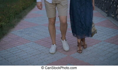 beautiful woman with man walking the street together