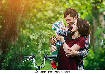 young family with a child on the nature - young family have...