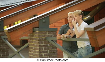 Gay men relaxing in the park. lgbt