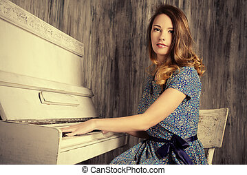 piano improvisation - Romantic young woman playing the...