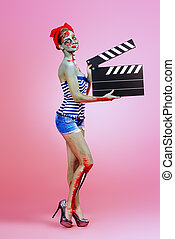 actress with clapperboard - Pin-up zombie woman holding...