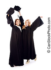 degree - Full length portrait of two joyful graduating...