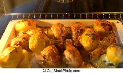 cooking a chicken and potato in stove