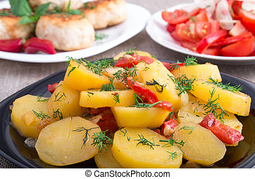 Stewed potatoes with bell pepper closeup - Natural homemade...