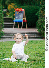 toddler boy showing metal salute