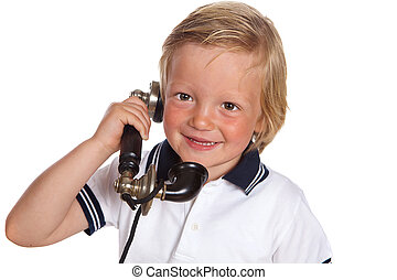 Boy with antique telephone - Blonde toddler boy playing with...