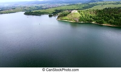 aerial view of castle on lake bank - aerial view of old...