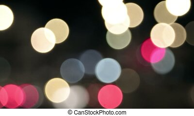 Abstract circular bokeh background of night city lights.