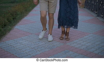 A warm summer evening in the city residential area. Couple...