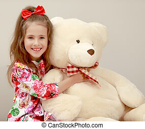 Girl with Teddy bear - Happy little girl with a long...