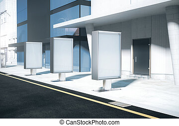 Row of empty ad posters - Row of blank ad stands on the...