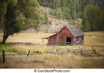 Barn in meadow. - An old red barn in the middle of an open...