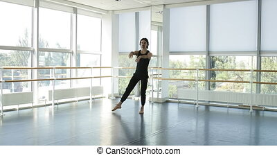 Dancing man modern ballet dancer performs dance in studio