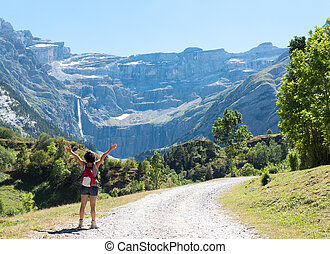 woman hiker and cirque de Gavarnie - A woman hiker and...