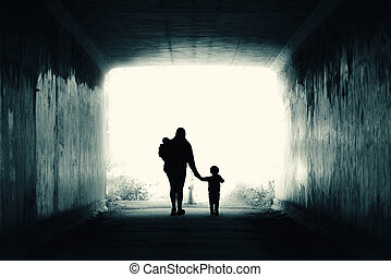 Into the Light - A single mother and two children walk into...