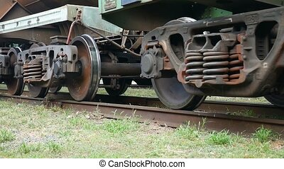 train gets under way on the iron video wheels spinning -...