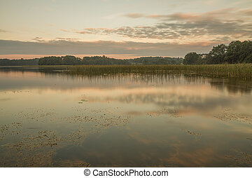 Calm lake water - Small lake in the evening, at sunset...