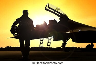 Military pilot on airfield walking away from the fighter jet