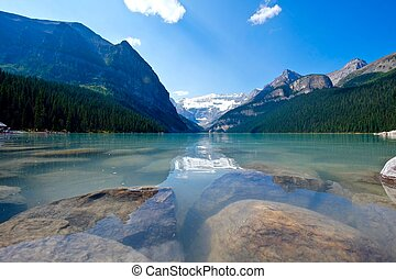 Mountains reflection in lake Louise. - Banff National Park....