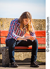 Man outdoor concerned and stressed - Man long hair alone on...