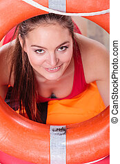 Lifeguard woman on duty with ring buoy lifebuoy. - Happy...