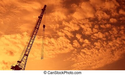crane boom with hook sunset video silhouette - crane boom...