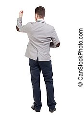 back view of writing business man in suit.