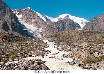 Sprign starts from Small Aktru glacier. Altay mountains.
