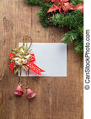 Christmas card on wooden top with xmas ornaments - Christmas...