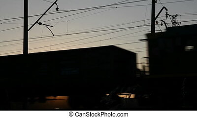 freight train against sunset - timelapse with freight train...