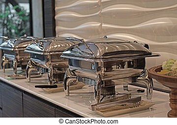 food service steam pans on buffet table - row of food...