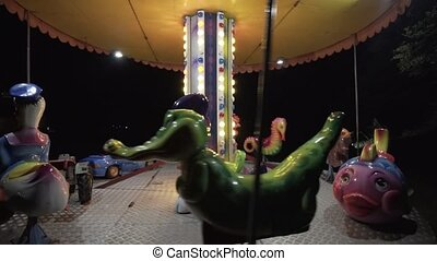 Children Carousel in the Park - Children's carousel in the...