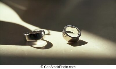 Wedding Ring Spinning on Marble Floor.