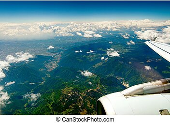 Mountains under the wing of the aircraft