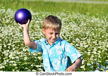 boy dropping ball - funny boy playing ball at the daisy...