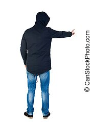 Back view of  pointing young men in parka.