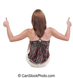 back view of siting young blonde woman showing thumb up....
