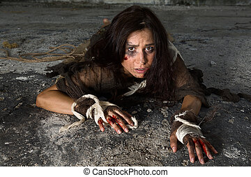 Horror scene with abused woman