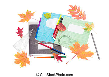 School exercise books, school supplies and yellow and red...
