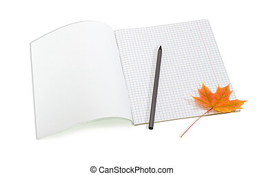 Open school exercise book, pencil and yellowed maple leaf -...