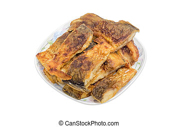 Slices of a fried fish on a white dish - White dish, filled...