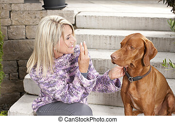 Attractive matured woman with her dog outdoor - Attractive...