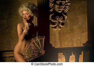 Half-naked Victorian lady posing in vintage interior -...
