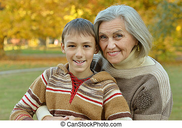 Grandmother with grandson in park - Portrait of a...