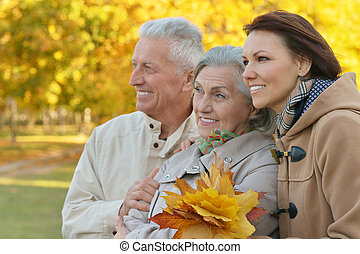 Daughter with senior parents in  park