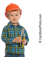 boy with a tool in the hands of - Cute little boy holding a...